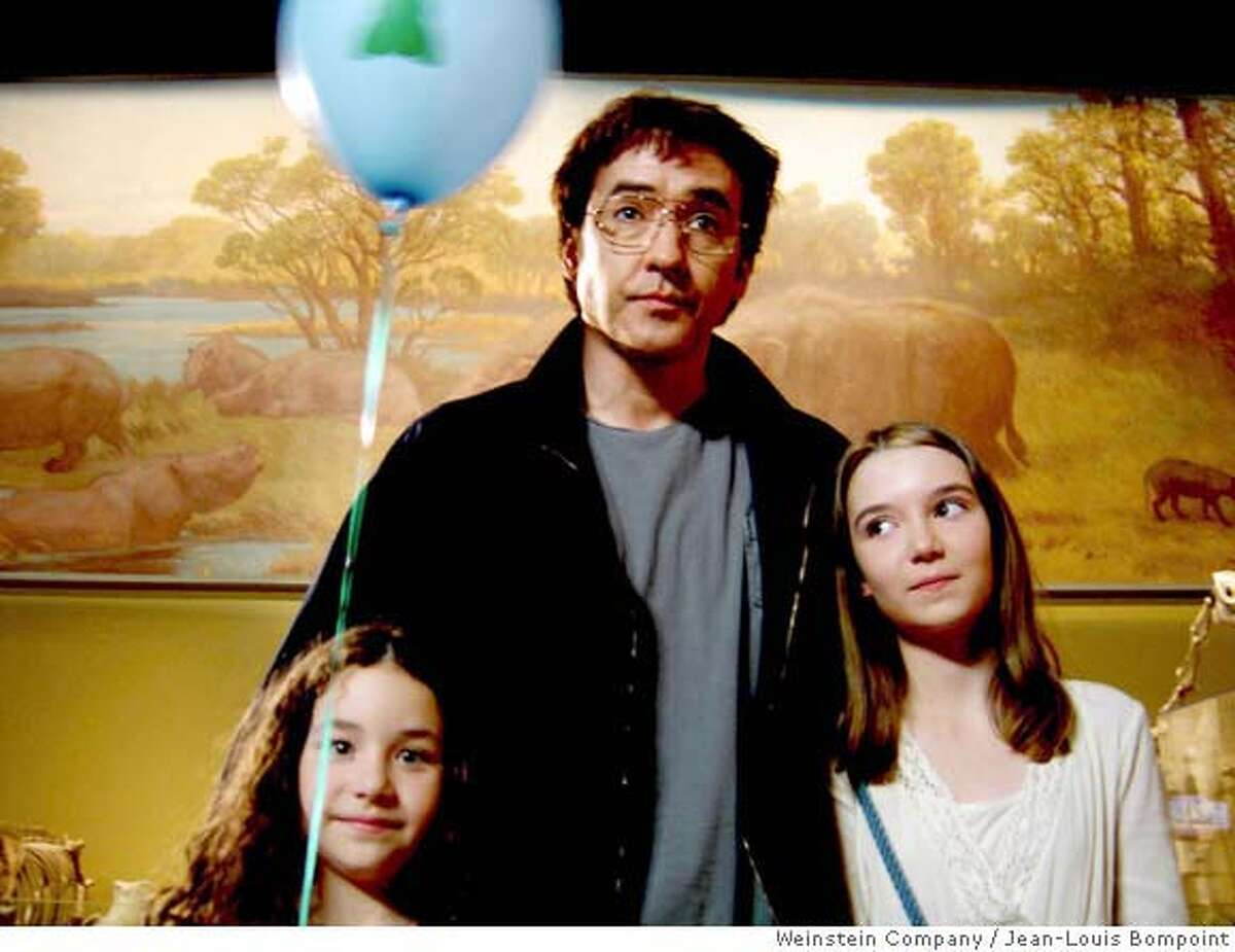In this photo provided by cinematographer Jean-Louis Bompoint, actor John Cusack, in the role of Stanley, tours Chicago's Field Museum, with daughters Dawn, portrayed by Gracie Boednarcyzk, and Heidi, played by Shelan O'Keefe, in a scene from the independent film