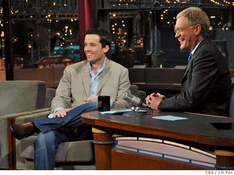 "In this photo released by CBS, New York Giants kicker Lawrence Tynes, left, discusses the Giants' overtime win against the Green Bay Packers in the NFC Championship football game with host David Letterman on the set of ""The Late Show with David Letterman,"" Wednesday, Jan. 23, 2008 in New York. The Giants will face the undefeated New England Patriots in the Super Bowl on Feb. 3. (AP Photo/CBS, J.P. Filo) **MANDATORY CREDIT; NO ARCHIVE; NO SALES; FOR NORTH AMERICAN USE ONLY** PHOTO PROVIDED BY CBS; MANDATORY CREDIT; NO ARCHIVE; NO SALES; FOR NORTH AMERICAN USE ONLY, AP PROVIDES ACCESS TO THIS PUBLICLY DISTRIBUTED HANDOUT PHOTO. THE COPYRIGHT IS OWNED BY A THIRD PARTY. EFE OUT Photo: J.P. Filo"