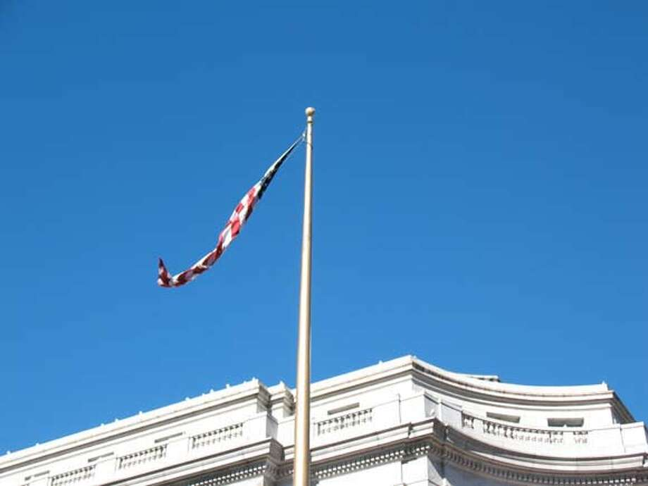 This US flag at UN Plaza needs to be attached at two corners, not one. Photo: Demian Bulwa