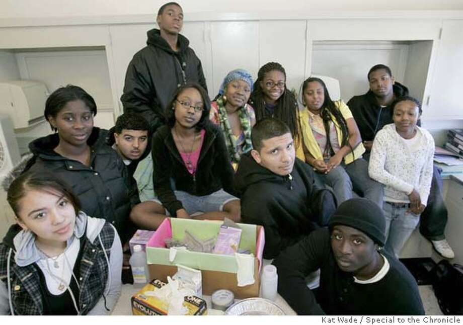 LEAD05_003_KW.JPG Excel High School 9th and 10th grade students from Ina Bendich's law academy class, (FRONT) Marla Monterroso, left, and Robert Brigham, right, (MIDDLE ROW L to R) Joyce Ominiona, Kalifa Mohamed, Jamelah Isaac and Juan Hernandez (BACK ROW L to R) Rocky Edwards, Kiyana Jones, Terranisha Nathaniel, De'Anna Young, Askari Smith and Whitney Aiken, who tested the air around the school for lead for an environmental law project and found lead, pose for a portrait in their classroom on Monday, February 4, 2008 in Oakland, Calif.. Photo by Kat Wade  Marla Monterroso, left, and Robert Brigham, right, (MIDDLE ROW L to R) Joyce Ominiona, Kalifa Mohamed, Jamelah Isaac and Juan Hernandez (BACK ROW L to R) Rocky Edwards, Kiyana Jones, Terranisha Nathaniel, De'Anna Young, Askari Smith and Whitney Aiken (CQ, Teacher, Ina Bendich) Mandatory Credit for photographer, Kat Wade No Sales/Mags out Photo: Kat Wade