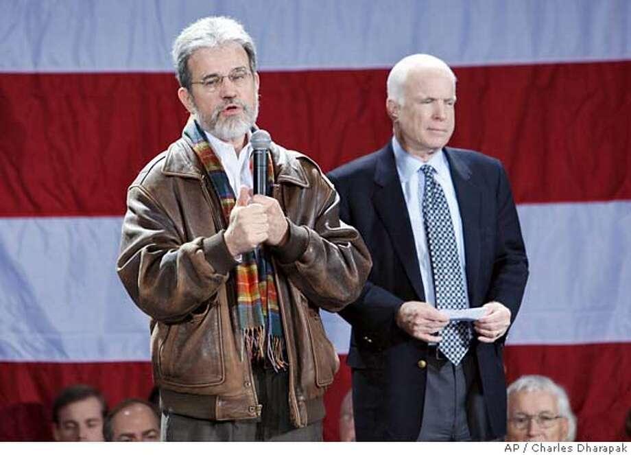 Sen. Tom Coburn, R-Okla., left, stumps for Republican presidential hopeful, Sen. John McCain, R-Ariz., at a campaign event in Spartanburg, S.C., Wednesday, Jan. 16, 2008. (AP Photo/Charles Dharapak) Photo: Charles Dharapak