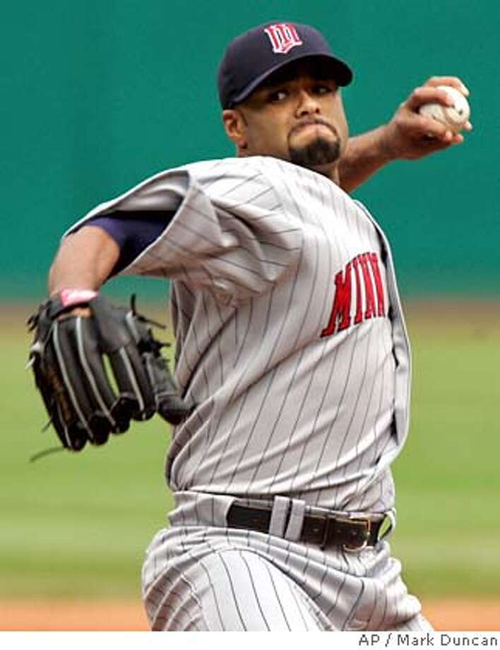 ** FILE ** Minnesota Twins pitcher Johan Santana delivers a pitch against Cleveland Indians' Casey Blake during a baseball game in this May 17, 2007 file photo, in Cleveland. Santana and the New York Mets completed contract negotiations on Friday, Feb. 1, 2008, the last major step needed to finalize the team's blockbuster trade with Minnesota. After the sides were granted an extra two hours to work on a deal, they finished negotiations before the new 7 p.m. EST deadline. The pitcher is scheduled to take a physical, the Mets said. (AP Photo/Mark Duncan, file) A MAY 17, 2007 FILE PHOTO EFE OUT Photo: Mark Duncan