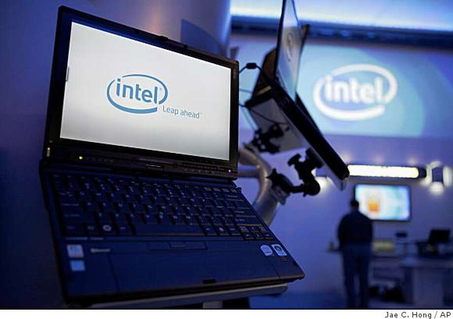 FILE - In this Jan. 7, 2009 file photo, Intel logos are seen on computer screens at the International Consumer Electronics Show (CES) in Las Vegas. Santa Clara, Calif.-based Intel on Thursday, June 4 said it plans to buy testing and development software maker Wind River Systems for $884 million. (AP Photo/Jae C. Hong, file) Photo: Jae C. Hong, AP