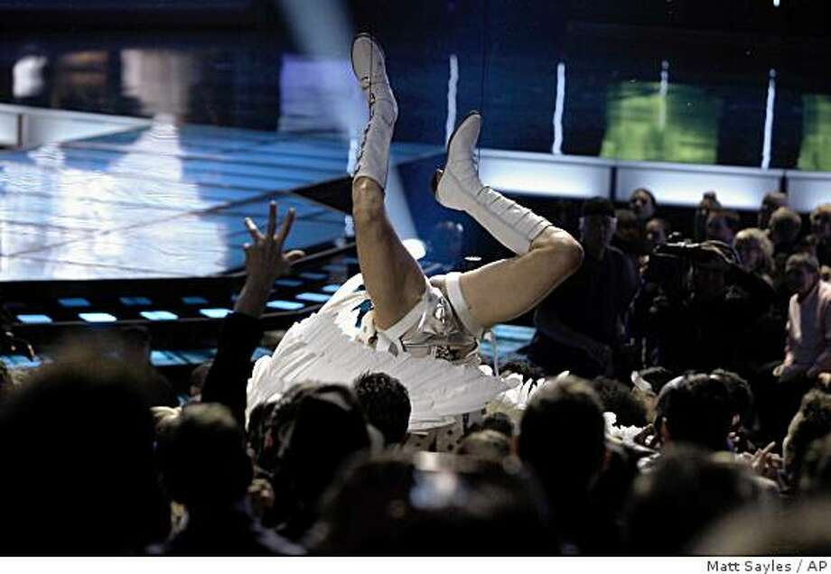 Sacha Baron Cohen, in character as Bruno, lands onto Eminem as he is lowered into the audience during the MTV Movie Awards on Sunday May 31, 2009, in Universal City, Calif. Photo: Matt Sayles, AP