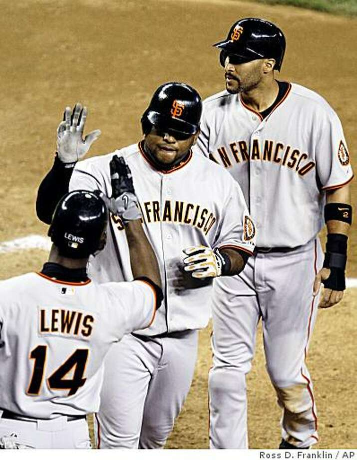 San Francisco Giants' Pablo Sandoval, center, is congratulated by teammates Randy Winn, top right, and Freddy Lewis (14) after Sandoval's two-run home run against the Arizona Diamondbacks in the fifth inning of a baseball game Tuesday, June 9, 2009, in Phoenix. Photo: Ross D. Franklin, AP