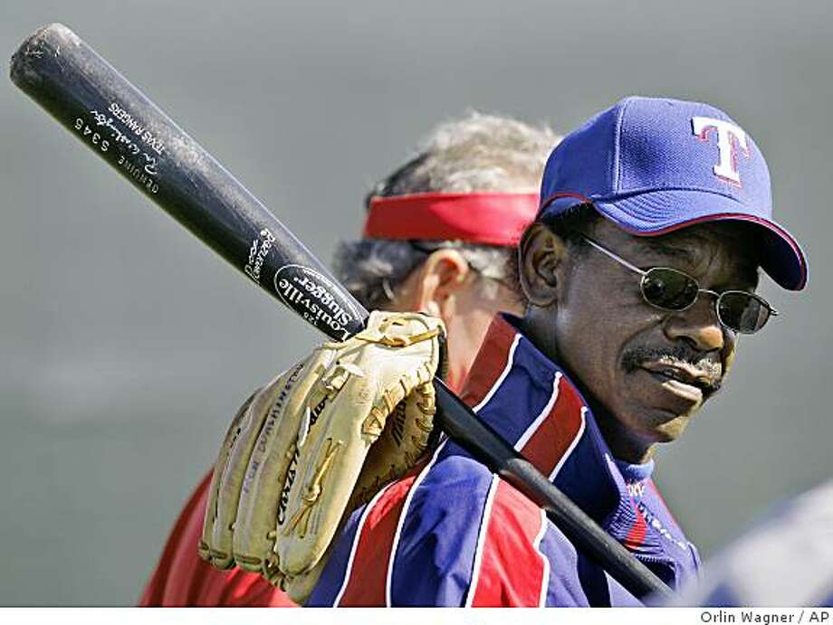 Texas Rangers manager Ron Washington walks between fields during baseball spring training in Surprise, Ariz., Monday, Feb. 26, 2007. (AP Photo/Orlin Wagner) Ran on: 03-18-2007 New skipper Ron Washington mesmerizes the media contingent, including Chronicle baseball writer John Shea (third from right). Photo: Orlin Wagner, AP