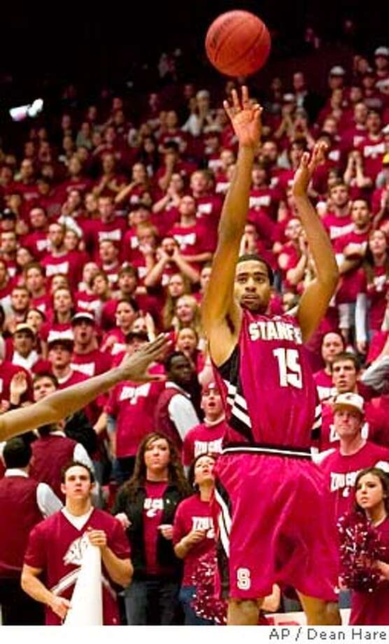 Stanford forward Lawrence Hill, right, shoots a three-point shot over a Washington State defender in the overtime period of a college basketball game Saturday, Feb. 2, 2008, at Beasley Coliseum in Pullman, Wash. Stanford won, 67-65. (AP Photo/Dean Hare) Photo: Dean Hare