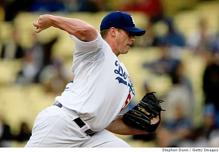 LOS ANGELES - JUNE 3:  Pitcher Chad Billingsley #58 of the Los Angeles Dodgers throws a pitch against the Arizona Diamondbacks  on June 3, 2009 at Dodger Stadium in Los Angeles, California.    (Photo by Stephen Dunn/Getty Images) Photo: Stephen Dunn, Getty Images
