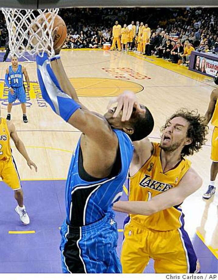 Los Angeles Lakers forward Pau Gasol (16) of Spain catches Orlando Magic center Dwight Howard (12) in the face as Howard shoots during the first half of Game 1 of the NBA basketball finals   Thursday, June 4, 2009, in Los Angeles.  (AP Photo/Chris Carlson) Photo: Chris Carlson, AP