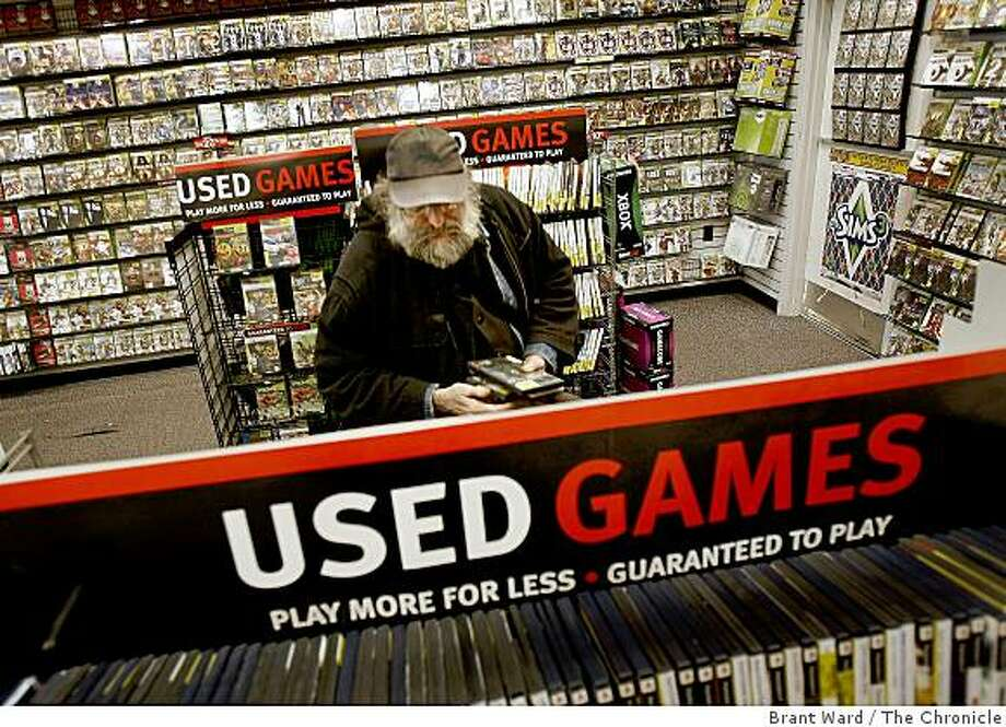 Neil Taylor of San Francisco loves games and purchased several used products at the Gamestop in San Francisco, Calif., on June 2, 2009.  Used games, sold at a discount at retailers like Gamestop are a boon to consumers. Game publishers argue they don't see any profit from the resale of their product. Photo: Brant Ward, The Chronicle