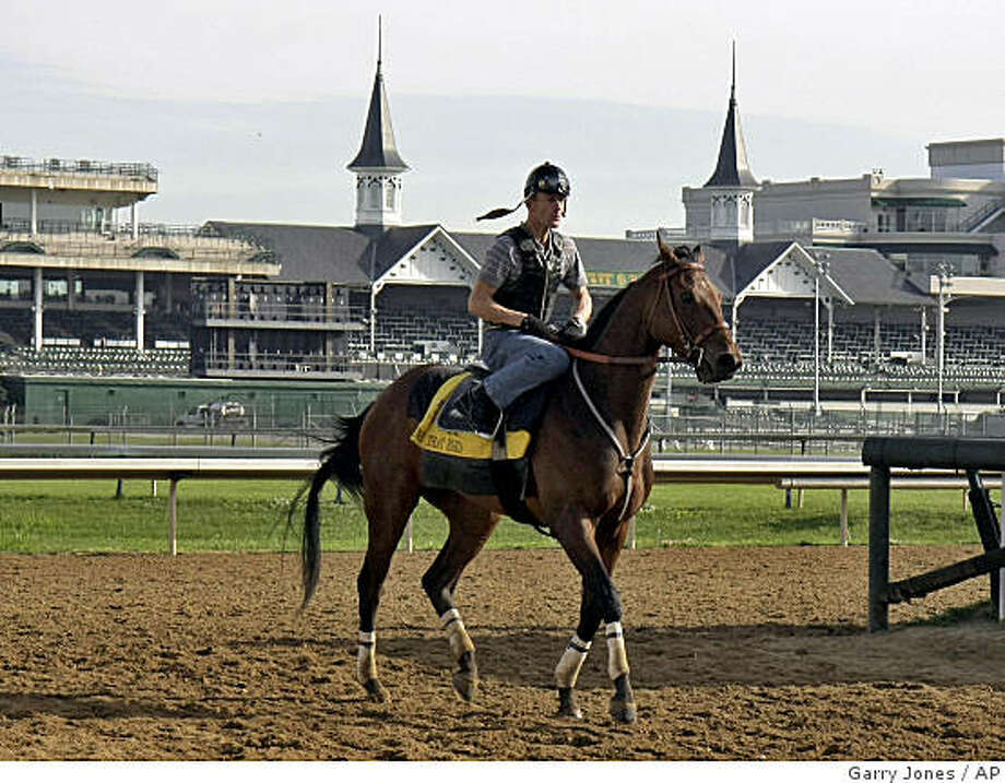 Mine That Bird, jockey Calvin Borel up, leaves the track at Churchill Downs in Louisville, Ky., Monday, June 1, 2009, following a workout in preparation for the Belmont Stakes. (AP Photo/Garry Jones) Photo: Garry Jones, AP