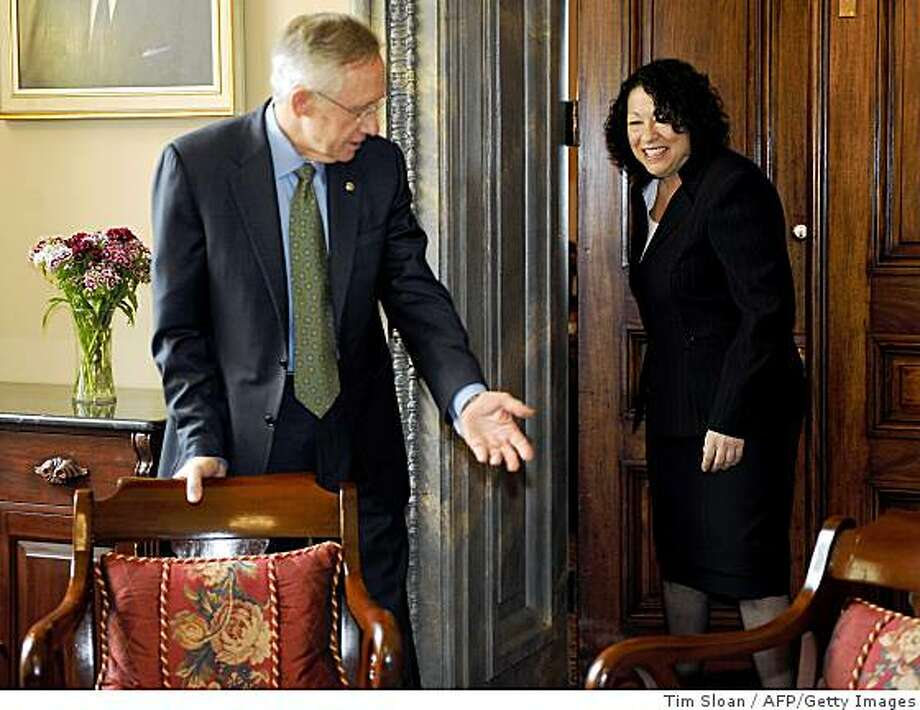 Supreme Court Justice nominee Sonia Sotomayor (R) meets with Senate Majority Leader Harry Reid (D-NV) June 2, 2009 on Capitol Hill in Washington, DC. Sotomayor is spending the day on Capitol Hill today, paying traditional courtesy calls on top lawmakers just a week after she was nominated.    AFP PHOTO / Tim Sloan (Photo credit should read TIM SLOAN/AFP/Getty Images) Photo: Tim Sloan, AFP/Getty Images