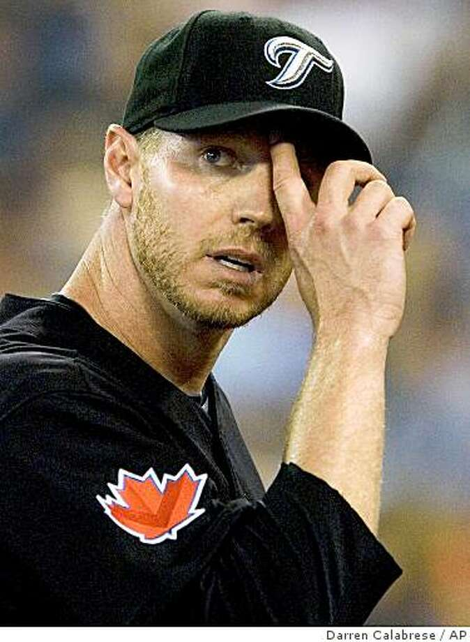 Toronto Blue Jays pitcher Roy Halladay looks out at the scoreboard during second-inning AL baseball game action against the Kansas City Royals in Toronto on Sunday, June 7, 2009. (AP Photo/The Canadian Press,Darren Calabrese) Photo: Darren Calabrese, AP