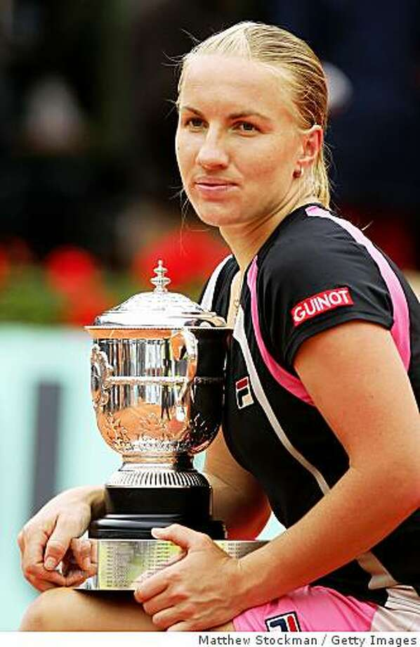 PARIS - JUNE 06:  Svetlana Kuznetsova of Russia poses with the trophy following her victory during the Women's Singles Final match against Dinara Safina of Russia on day fourteen of the French Open at Roland Garros on June 6, 2009 in Paris, France.  (Photo by Matthew Stockman/Getty Images) Photo: Matthew Stockman, Getty Images