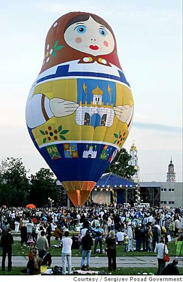 RUSSIA DOLLS: The historic town of Sergiyev Posad in Russia is considered the birthplace of matryoshki, the wooden nesting dolls that are synonymous with Russian folk art; the town commissioned a matryoshka hot-air balloon to promote tourism. Illustrates RUSSIA-DOLLS (category i), by Sarah Schafer, Special to The Washington Post. Moved Sunday, May 31, 2009. (MUST CREDIT: Sergiyev Posad Government.) The  historic town of Sergiyev Posad in Russia is considered the birthplace of matryoshki, the wooden nesting dolls that are synonymous with Russian folk art; the town commissioned a matryoshka hot-air balloon to promote tourism. Illustrates RUSSIA-DOLLS (category i), by Sarah Schafer, Special to The Washington Post. Moved Sunday, May 31, 2009. (MUST CREDIT: Sergiyev Posad Government.) Photo: Courtesy, Sergiyev Posad Government