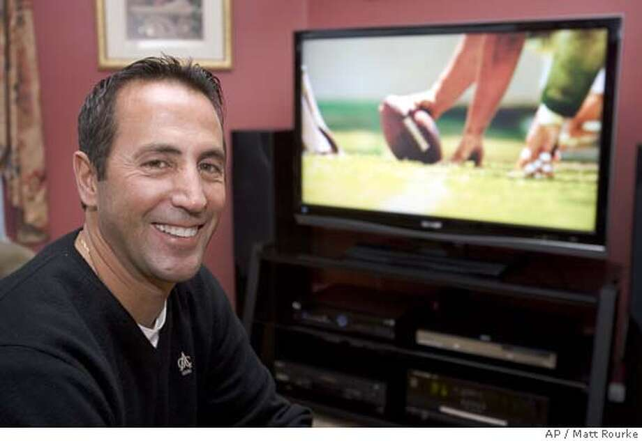 Jim Ferrero poses for a photograph with his new TV at his home in Yardley, Pa., Monday, Jan. 28, 2008. Super Bowl Sunday may be the biggest day of the year for football fans, but it's also a big day for people who sell big screen TVs, recliners and pizza. (AP Photo/Matt Rourke) Photo: Matt Rourke