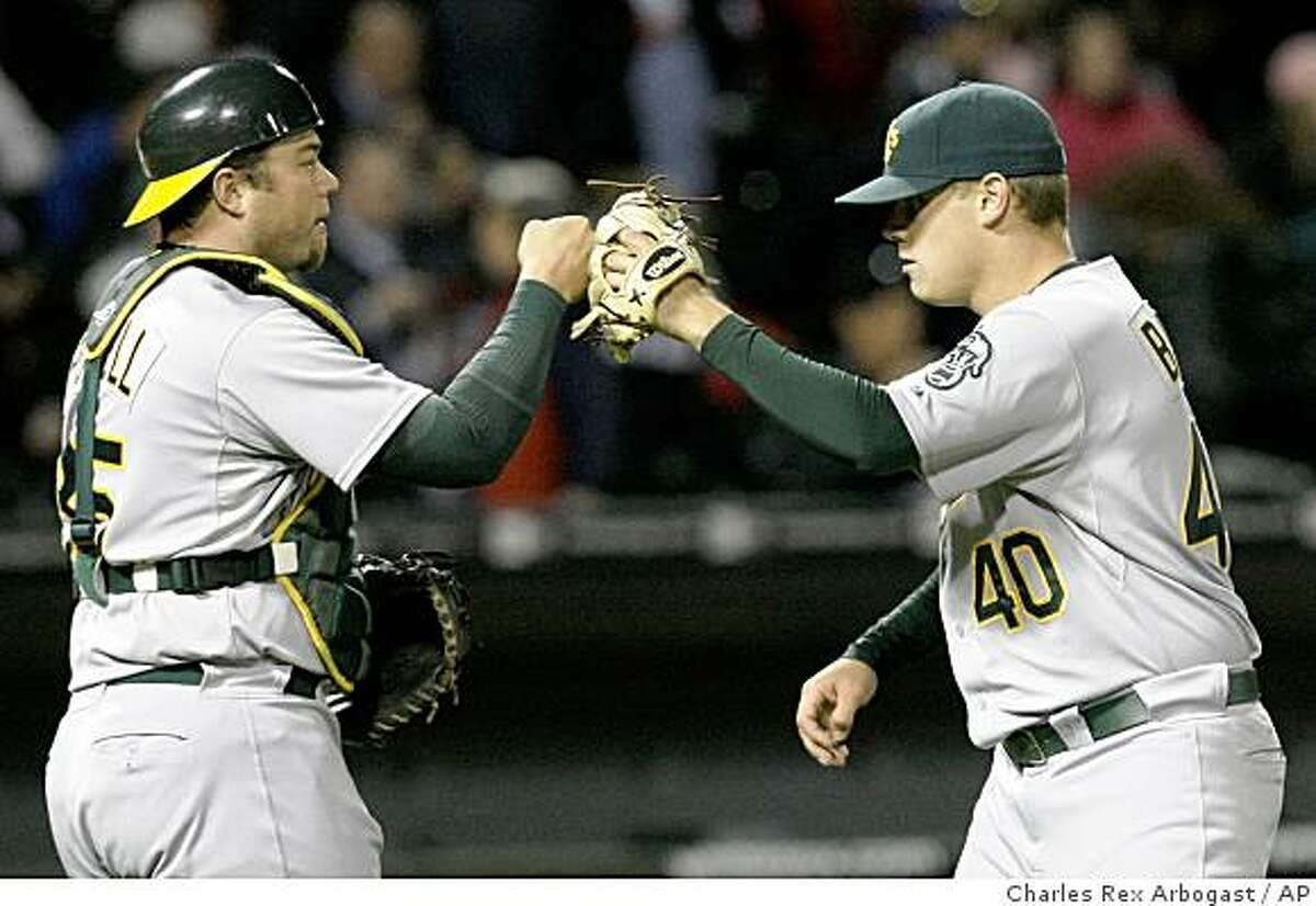 Oakland Athletics catcher Landon Powell, left, celebrates with relief pitcher Andrew Bailey after Oakland's 5-3 win over the Chicago White Sox in a baseball game Wednesday, June 3, 2009, in Chicago. Bailey earned a save.