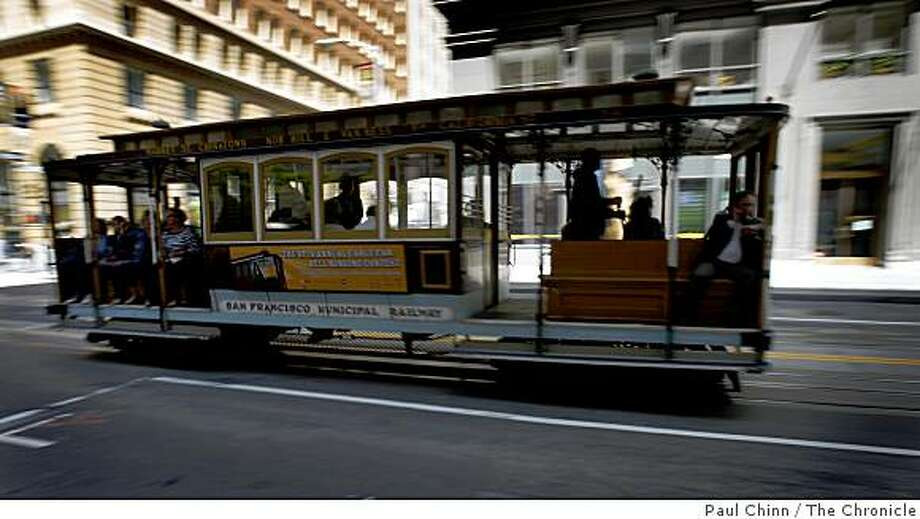 A California Street cable car rolls through the heart of the Financial District in San Francisco, Calif., on Thursday, May 21, 2009. A new Board of Realtors map to be released soon will rename the area as the Barbary Coast neighborhood. Photo: Paul Chinn, The Chronicle