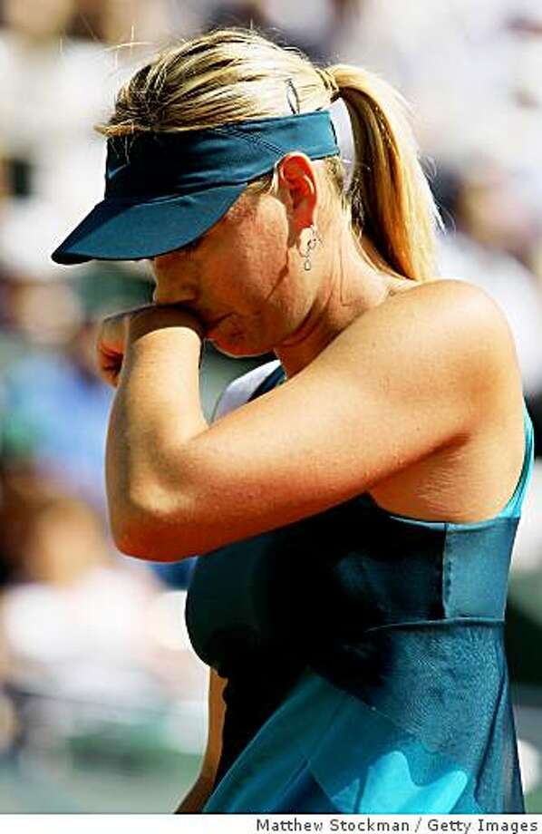 A dejected Maria Sharapova falls Dominika Cibulkova of Slovakia in straight sets at the French Open at Roland Garros on June 2, 2009 in Paris, France. Photo: Matthew Stockman, Getty Images