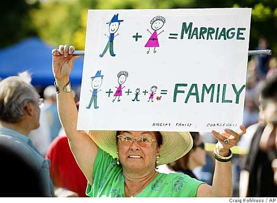 Sylvia Higgins of Coursegold holds a sign while attending a rally at City Hall to show support for the voter-approved ban on same-sex marriage in California, a day after thousands marched in the area against the ban Sunday, May 31, 2009 in Fresno, Calif.  (AP Photo/The Fresno Bee, Craig Kohlruss) Photo: Craig Kohlruss, AP