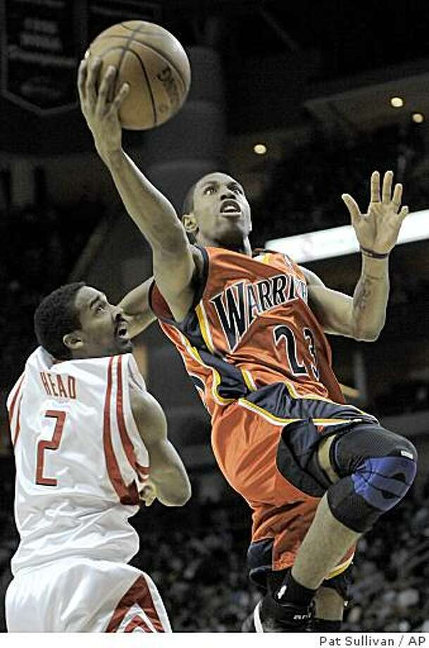 Golden State Warriors' C.J. Watson (23) goes for two points over Houston Rockets defender Luther Head (2) during the first half of a basketball game Tuesday, Jan. 29, 2008 in Houston. (AP Photo/Pat Sullivan) Photo: Pat Sullivan, AP