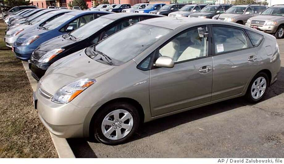 **FILE** Unsold 2007 Prius hybrid sedans sit on the lot of a Toyota dealership in Boulder, Colo., on Sunday, Feb. 18, 2007. Hybrid vehicles are on track to achieve record U.S. sales this year despite signs consumer interest in hybrids is waning, an auto information company said Thursday.(AP Photo/David Zalubowski, file)  Ran on: 08-03-2007  Unsold 2007 Prius hybrids sit on a lot in Boulder, Colo. Sales of the top-selling hybrid have been helped by incentives from Toyota. FEB. 18, 2007 FILE PHOTO Photo: David Zalubowski