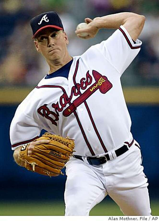 -- FILE -- In this Aug. 2, 2002, file photo, Atlanta Braves starting pitcher Tom Glavine throws to a St. Louis Cardinals batter in the first inning of a baseball game in Atlanta. The Braves released 305-game winner Glavine on Wednesday, June 3, 2009. (AP Photo/Alan Mothner,file) Photo: Alan Mothner, File, AP
