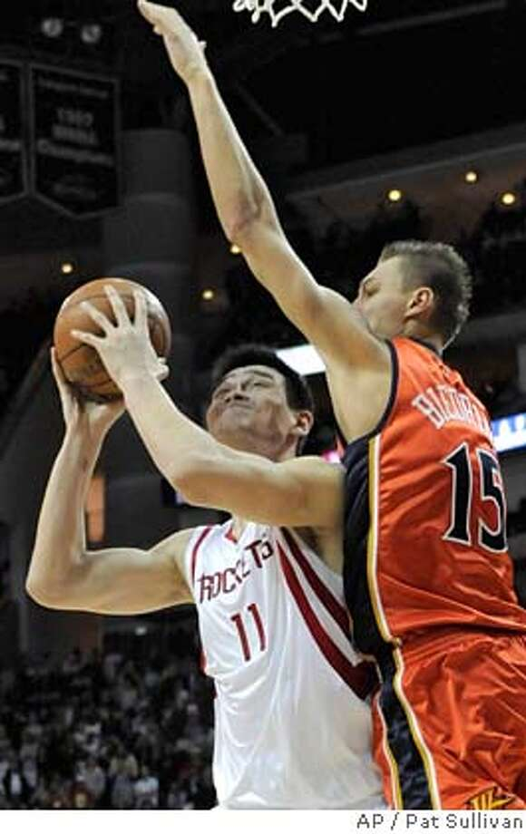 Houston Rockets center Yao Ming (11) of China is fouled by Golden State Warriors' Andris Biedrins (15) of Latvia during the second half of a basketball game Tuesday, Jan. 29, 2008 in Houston. Houston won 111-107. (AP Photo/Pat Sullivan) EFE OUT Photo: Pat Sullivan