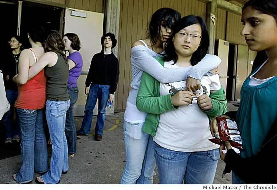Prachi Mistry and Yvonne Lin, embrace in front of the little theater, on Wednesday June 3, 2009, at Gunn High School in Palo Alto, Calif., where they took drama classes with their friend Sonya Raymakers who was killed by a CalTrain last evening at the East meadow crossing. Photo: Michael Macor, The Chronicle