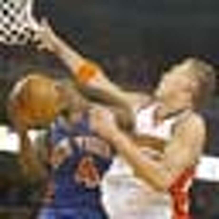 California Golden State Warriors Andris Biedrins stops New York Knicks Nate Robinson from scoring in the second half of the game, Sunday January 27, 2008, in Oakland, Ca. (Lacy Atkins San Francisco Chronicle) Photo: Lacy Atkins