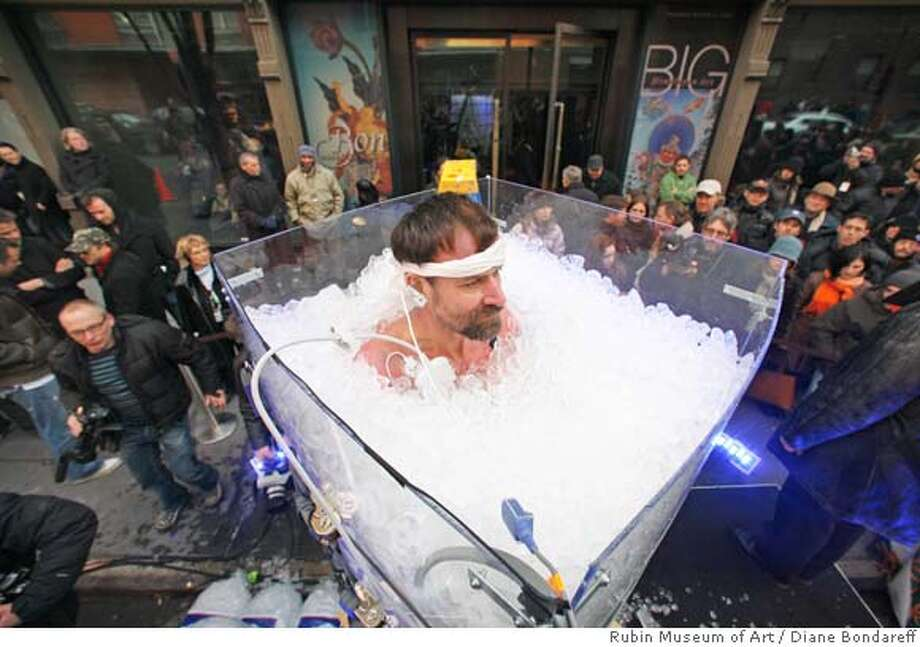 "In this photo provided by Rubin Museum of Art, Wim Hof, of the Netherlands, stands up to his neck in ice for an hour and twelve minutes, Saturday, Jan. 26, 2008, outside the Rubin Museum of Art in New York, during a successful attempt to break his previous world record for immersion in an outdoor ice bath. Known as ""The Iceman,"" Mr. Hof controls his body temperature by the tantric practice of tumo and is the only non-Tibetan in the world to have mastered this art. (AP Photo/Rubin Museum of Art, Diane Bondareff) **NO SALES** Photo: Diane Bondareff"