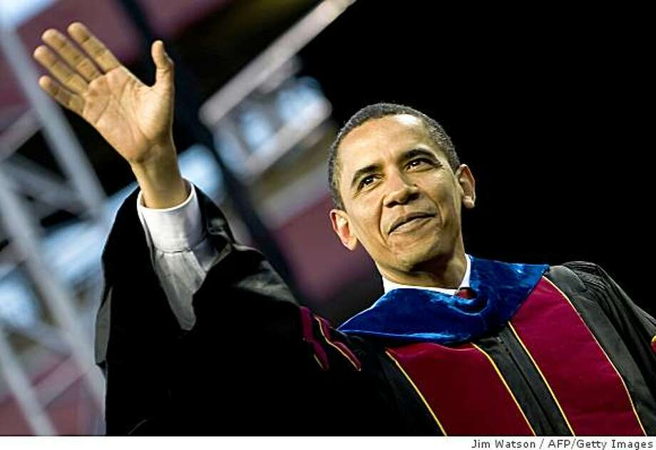 US President Barack Obama waves to the crowd as he arrives during the Arizona State University commencement ceremony at Sun Devil Stadium in Tempe, Arizona May 13, 2009.  AFP  PHOTO/Jim WATSON (Photo credit should read JIM WATSON/AFP/Getty Images) Photo: Jim Watson, AFP/Getty Images