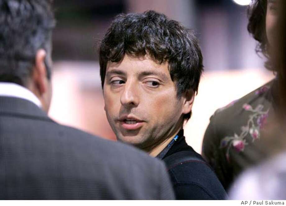 **FILE** Google co-founder Sergey Brin walks the exhibit hall at the Consumer Electronics Show (CES) in Las Vegas in this Jan. 9, 2008 file photo. Google is expected to release quarterly earnings after the market closes Thursday, Jan. 31, 2008. (AP Photo/Paul Sakuma, file) Photo: Paul Sakuma