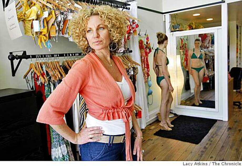 Zoe Magee poses with her bikinis selections in her shop, Wed. May 27, 2009, in San Francisco, Calif. Photo: Lacy Atkins, The Chronicle