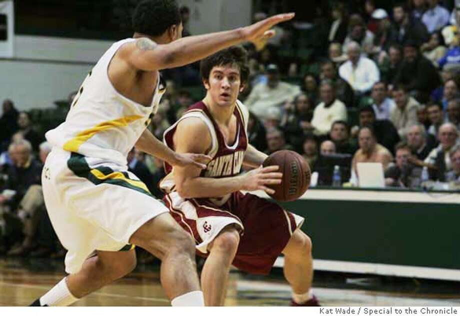usfMEN_076_KW.JPG Santa Clara guard Brody Angley (5) looks for a path while guarded by San Francisco forward Dior Lowhorn during the first half when the San Francisco Dons men's basketball host the Santa Clara Broncos at Memorial Gym on Monday, January 28, 2008 in , Calif.. Ran on: 01-29-2008  Santa Clara's Brody Angley checks his options under the defensive watch of USF's Dior Lowhorn in the Broncos' 66-48 victory at Memorial Gym on Monday night. More often than not, the Broncos found a way past the Dons, whose errors kept coach Eddie Sutton at 799 career wins. Go to SFGate.com for the complete story. Photo: Kat Wade
