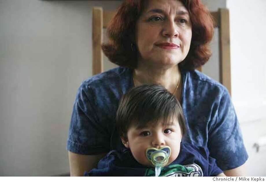 Guadalupe Siordia Ortiz, with her grandson Francisco Ortiz, 1, says she hasn't made up her mind about the upcoming election completely but thinks Hillary Clinton might have and edge over Obama, whom she feels might lack in experience.  Mike Kepka / The Chronicle Ran on: 02-01-2008 Photo: Mike Kepka