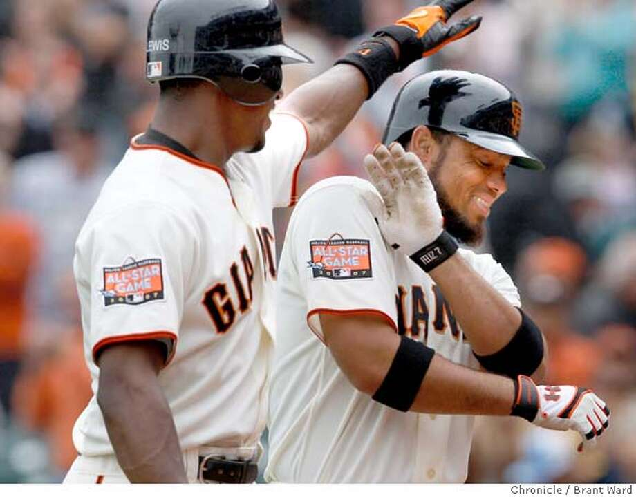 giants_269.JPG  The Giants Fred Lewis playfully hit Pedro Feliz after Feliz's home run in the 6th inning tied the game.  San Francisco Giants action against the Cincinnati Reds at AT&T Park Sunday including photos of Barry Bonds on the bench with a toe injury.  {By Brant Ward/San Francisco Chronicle}9/23/07 Photo: Brant Ward