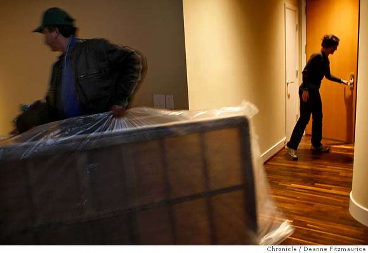 .jpg Denise McCullough closes her front door as her mattress is delivered, at left. She and her husband, a couple from Victoria, Canada bought a condo in San Francisco as it became affordable since the drop in value of the US Dollar. Photographed in San Francisco on 1/11/08. Deanne Fitzmaurice / The Chronicle Mandatory credit for photographer and San Francisco Chronicle. No Sales/Magazines out.