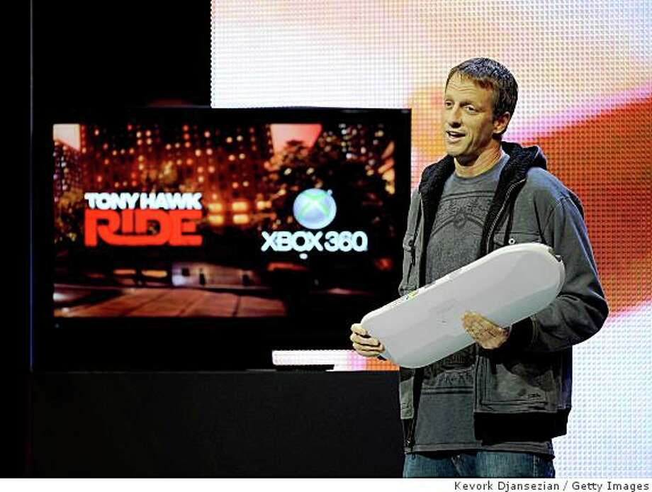"""LOS ANGELES, CA - JUNE 01:  Professional skateboarder Tony Hawk introduces the new XBox 360 game """"Tony Hawk Ride"""" at Microsoft's  XBox 360 media briefing to open the Electronic Entertainment Expo (E3) on June 1, 2009 in Los Angeles, California.  The Electronic Entertainment Expo (E3) is a three-day event dedicated to the gaming industry.  (Photo by Kevork Djansezian/Getty Images) Photo: Kevork Djansezian, Getty Images"""