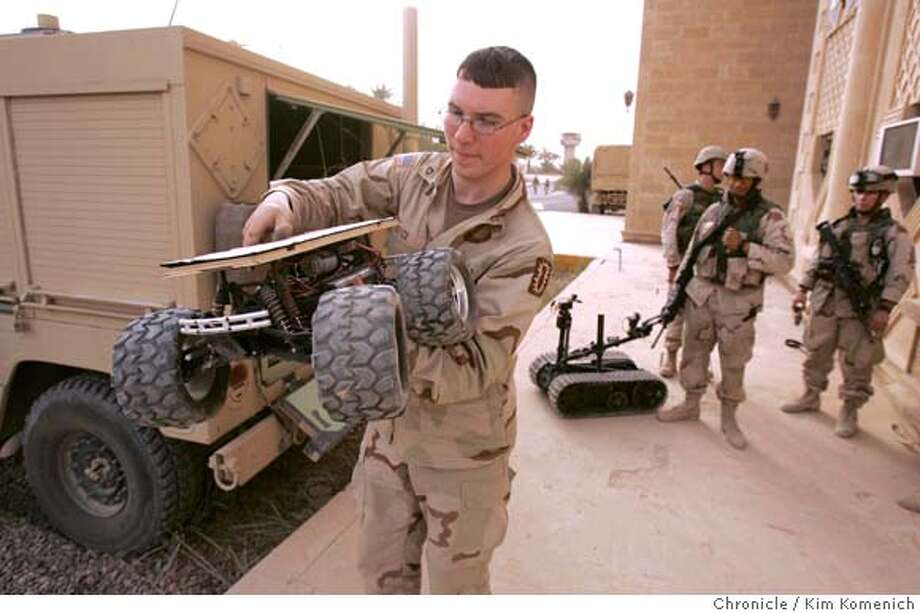 IRAQ13_BOATS_KK_008.jpg  PFC Matthew Boyce of Sanbornton, New Hampshire holds a remote-controlled vehicle the EOD will use to deliver C4 explosives under suspicious vechicles determined to hold car bombs. The remote vehicle rolls under the car and the EOD techs detonate the C4 from a safe distance. Needless to say, these $300-plus vehicles are good for one use only.  We join soldiers from Easy Company of the U.S. Army's 2-7 Infantry Battalion of the 1st Brigade, 3rd Infantry Division on River Patrol on the Tigris River and later in the day we join the 2-7's Explosive Ordinance Disposal team as they detonate two caches of shells north of Tikrit. San Francisco Chronicle photo by Kim Komenich Photo: Kim Komenich