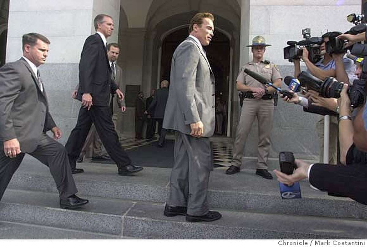 arnold23_0048.JPG photo taken on 10/22/03 in Sacramento. California Governor-elect Arnold Schwarzenegger in between and his security detail and handlers and the media at the Capitol building. He entered the state capitol building today to meet with various state political leaders CHRONICLE PHOTO BY MARK COSTANTINI MANDATORY CREDIT FOR PHOTOG AND SF CHRONICLE/NO SALES-MAGS OUT