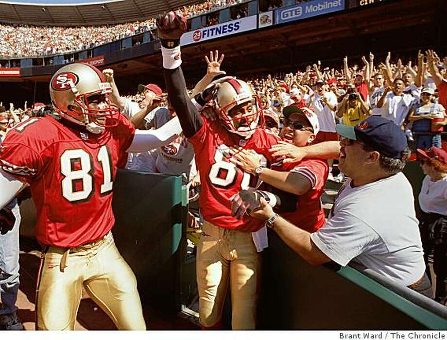 49ERS-RICE TD/C/06SEP98/SP/BW--49ERS-RICE TD/06SEP98/SP/BW--Jerry Rice was mobbed by 49er fans after he scored his first touchdown of the season Sunday in the third quarter. Fans rushed to congratulate him, Terrell Owens is at left. By Brant Ward/Chronicle Photo: Brant Ward, The Chronicle