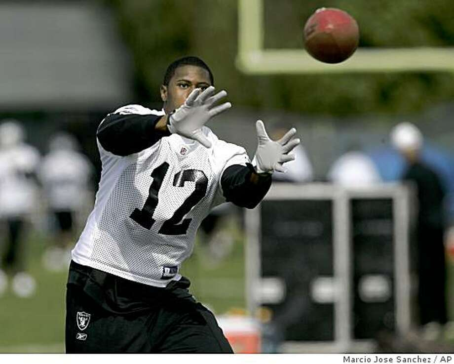 Oakland Raiders first round pick Darrius Heyward-Bey goes through catching drills during training camp in Alameda, Calif., Wednesday, June 3, 2009. Photo: Marcio Jose Sanchez, AP