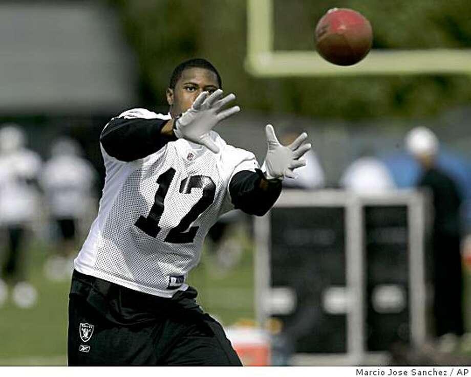 Oakland Raiders first round pick Darrius Heyward-Bey goes through catching drills during training camp in Alameda, Calif., Wednesday, June 3, 2009. Photo: Marcio Jose Sanchez, AP