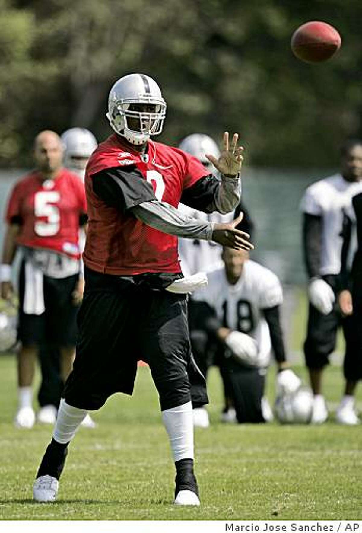 Oakland Raiders quarterback JaMarcus Russell throws a pass during training camp in Alameda, Calif., Wednesday, June 3, 2009.