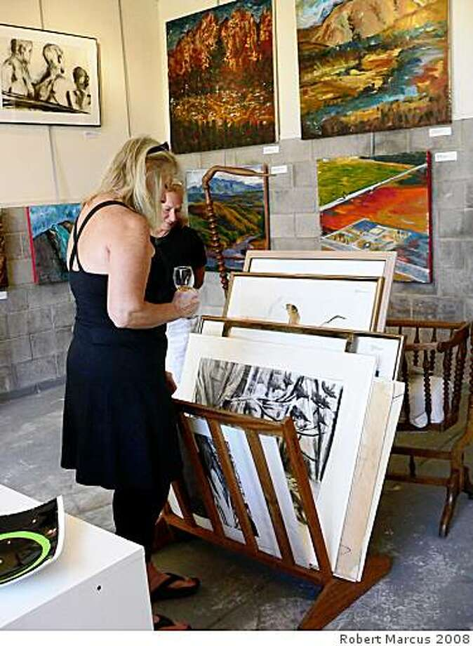 Visitors at studio showing works of two artists: Branka Harris, Glass: fused glass, oil paintings, jewelryandHanya Popova Parker, Painting & Drawings: landscape,  figurative & abstract Photo: Robert Marcus 2008