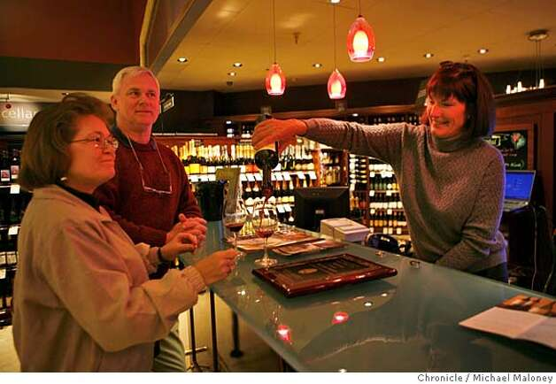 Fourth generation wine grower Carolyn Wente (right) tends the wine bar at the Livermore, CA Safeway, pouring a sample of her wine to out of towners Pete and Vera Peterson of Amherst, Ohio. They were in the area on business and stopped at the store for a sandwich on January 22, 2008. The Livermore Safeway offers daily wine tasting, inviting local winemakers to pour samples of their wines to customers. Photo by Michael Maloney / The Chronicle MANDATORY CREDIT FOR PHOTOG AND SAN FRANCISCO CHRONICLE/NO SALES-MAGS OUT Photo: Michael Maloney
