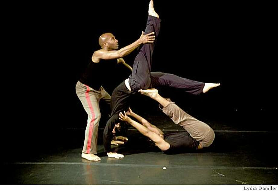 The SF Moving Men (Corey Brady left, Sebastian Grubb above and Theo Turner below) rehearse a new work by choreographer Joe Landini. Photo by Lydia Daniller Photo: Lydia Daniller