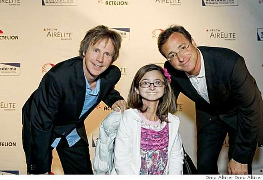 San Francisco-based Scleroderma Research Foundation held its Cool Comedy ?Hot Cuisine benefit at the Palace Hotel. The event raised more than $500,000 for medical research aimed at finding improved therapies and, ultimately, a cure for people living with scleroderma. Dana Carvey, Marina Duque and Bob Saget.Dana Carvey, Marina Duque, Bob Saget Photo: Drew Altizer Drew Altizer
