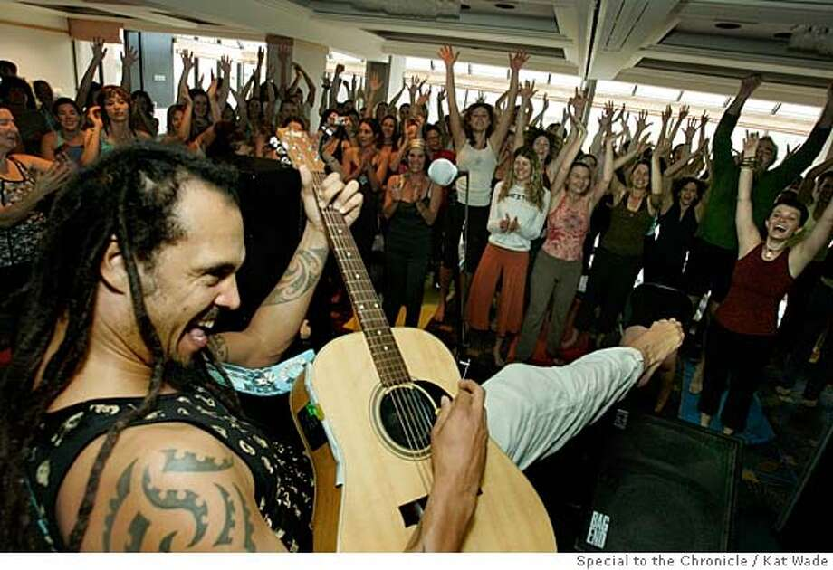 """YOGA27_268_KW.JPG  Local musician Michael Franti, left, encourages the participants in the yoga class , """"Move and Be Moved,"""" to move and dance during the 5th Annual Yoga Journal San Francisco Conference in the Garden Room of the Hyatt Regency Embarcadero on Sunday, January 20, 2008 in San Francisco, Calif. Michael Franti (CQ, Subject) Mandatory Credit for photographer, Kat Wade No Sales/Mags out Photo: Kat Wade"""